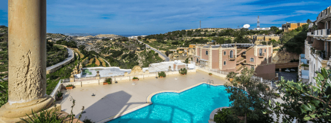 Pool area at Madliena Village | Perry Estate Agents